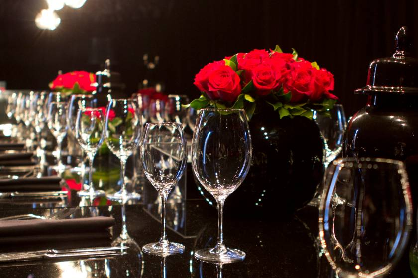 Gala dinner table setting with flowers